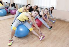 Sport Concepts. Group of Five Female Sportswomen Having Legs Muscles Exercises Stock Photo
