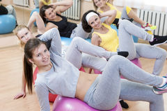 Sport Concepts. Group of Five Laughing Smiling Caucasian Females Having Muscles Stretching Exercises Stock Image