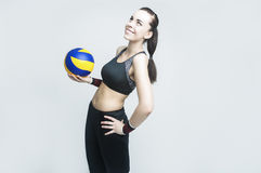 Sport Concepts and Ideas. Professional Female Volleyball Athlete With Ball Stock Photography