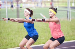 Sport Concepts and Ideas. Two Professional Female Athletes Having Training At Sport Venue Outdoors Royalty Free Stock Photography