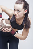Sport Concepts: Professioanl Female Soccer Player With Ball for Stock Photography