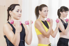 Sport Concepts. Three Caucasian Fit Women Performing Exercises Stock Images
