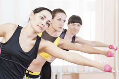 Sport Concepts. Three Caucasian Fit Women Performing Exercises Stock Photos
