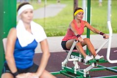 Sport concepts. Two positive caucasian female athlete in good fit. Sport Concepts.Two Positive Caucasian Female Athlete in Good Fit Having Training on Stock Image