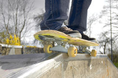 Sport conceptual image. Skateboarder doing a slide. Picture of skateborad Stock Images