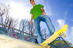Sport conceptual image. Teenage skateboarder standing on the ramp with skateboard Royalty Free Stock Image