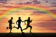 Sport correnti Atleti della concorrenza tre corridori Fotografia Stock