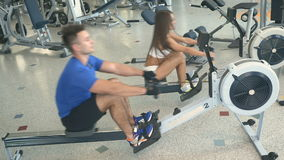 Sport couple doing cardio exercises in the gym stock footage