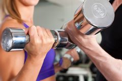 Sport - couple is exercising with barbell in gym Royalty Free Stock Photo