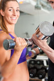 Sport - couple is exercising with barbell in gym Royalty Free Stock Photography