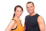 Sport couple. In front of white background Royalty Free Stock Photography
