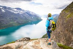 Sport couple hiking on Besseggen. Hikers enjoy beautiful lake and good weather in Norway. Sport woman hiking on Besseggen. Hiker enjoy beautiful lake and good Royalty Free Stock Photography