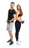 Sport couple - man and woman with dumbbells on the white Stock Photo