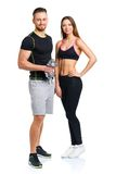 Sport couple - man and woman with dumbbells on the white Royalty Free Stock Photography