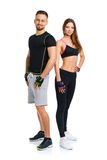 Sport couple - man and woman after fitness exercise on the white Stock Photos