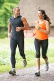 Sport couple running Stock Photos