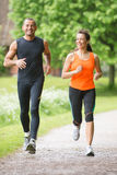 Sport couple running Royalty Free Stock Photography