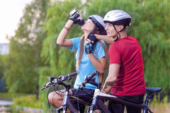 Sport and cycling Concept: Young Caucasian Cyclist Resting Toget Stock Photo