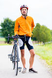 Sport Cyclist with bike having break Royalty Free Stock Image