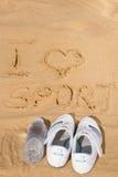 Sport d'amour du signe I en sable Images stock