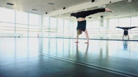 Sport dancer shooting video about training for social networks. Sport dancer shoot video about training for social networks, young man doing acrobatic stunts in stock video footage