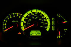 Dash Gauges. Illuminated dash from a newer Import Stock Image