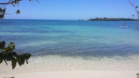 Sport de panneau de palette sur une belle plage Image libre de droits