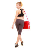 sport De retour de la fille sportive de forme physique dans les vêtements de sport avec le sac de gymnase Photos stock