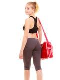 sport De retour de la fille sportive de forme physique dans les vêtements de sport avec le sac de gymnase Images stock