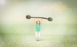 Sport di sollevamento di pesi del bambino Fotografie Stock Libere da Diritti