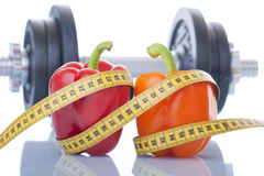 Sport and diet. Healthy food and exercise for a slim line Stock Photography