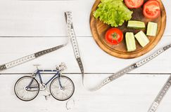 Sport and diet concept -  bicycle model, fresh vegetables and ce Stock Photo