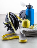 Sport and diet concept with weight exercise accessorie. S, a measuring tape and apple for healthcare at the gym Royalty Free Stock Photo