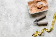 Sport and diet nutrition equipment on stone background top view space for text. Sport and diet nutrition with equipment on stone background top view space for Royalty Free Stock Photos