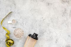 Sport diet protein nutrition and fitness equipment on stone background top view mock up. Sport diet protein nutrition and fitness equipment on gray stone Royalty Free Stock Image