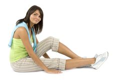 Sport dressed woman does exercise Royalty Free Stock Image