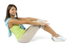 Sport dressed woman does exercise Stock Photo