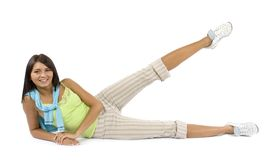 Sport dressed woman does exercise Stock Photography
