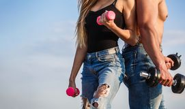 Sport, dumbbell, fitness, couple sports. Sportive woman and man, team. Sporty couple showing muscle and workout. Sport, dumbbell, fitness, couple sports stock image