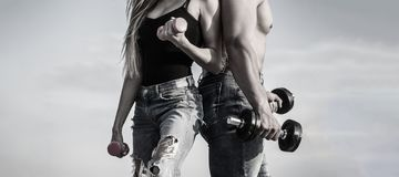 Sport, dumbbell, fitness, couple sports. Sportive woman and man, team. Sporty couple showing muscle and workout