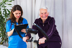 Sport effort tests. Geriatrician taking notes about the effort capacity of an elderly women in a nursing home Royalty Free Stock Images