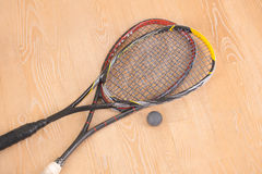 Sport equiment rackets and ball on floor stock image