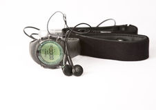 Sport equipement. Sport watch with hart monitor, pulse meter wrist and earphones with mp3 player Royalty Free Stock Photos