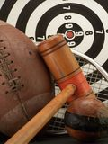 Sport equipment. Sporting equipment including a football, mallet, ball, dart board and racket Stock Images