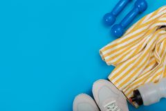 Sport equipment on blue background, top view. Concept healthy lifestyle, healthy food, sport and diet royalty free stock images