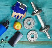 Sport Equipment. Dumbbells, Free Weights, Sport Gloves, Phone With Earphones. Sport Equipment. Dumbbells, Free Weights, Barbell, Hand Grip, Sport Gloves, Juice Royalty Free Stock Photography