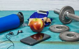 Sport Equipment. Dumbbells, Free Weights, Sport Gloves, Phone With Earphones. Sport Equipment. Dumbbells, Free Weights, Barbell, Hand Grip, Sport Gloves, Juice Stock Photography