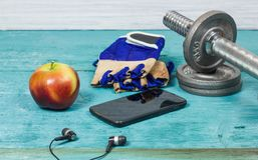 Sport Equipment. Dumbbells, Free Weights, Sport Gloves, Phone With Earphones. Sport Equipment. Dumbbells, Free Weights, Barbell, Hand Grip, Sport Gloves, Juice Stock Photos