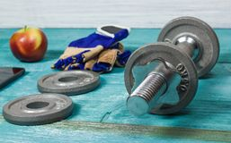 Sport Equipment. Dumbbells, Free Weights, Sport Gloves, Phone With Earphones Stock Photos