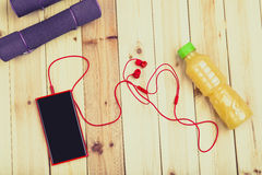 Sport Equipment. Dumbbells, Juice, Phone. Royalty Free Stock Photography